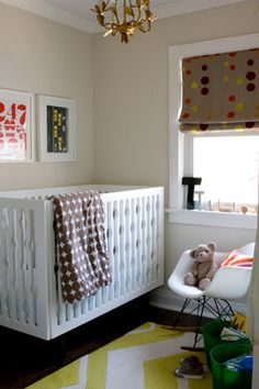 Walmart mod line crib. dwell bedding. DIY accents on the shade and etsy art.