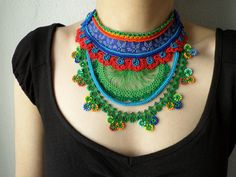 New to irregularexpressions on Etsy: colorful freeform crochet bib necklace -  statement necklace with red cornflower blue and green beaded crochet flowers (188.00 USD)