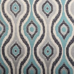 A modern geometric upholstery fabric in an abstract ogee design of navy blue, aqua, silver grey and ivory. This woven fabric is suitable for