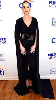 Katy Perry in a black jumpsuit with cape sleeves
