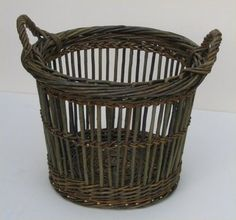 willow basket--Always loved this willow basket; wonderful for firewood, white towels, anything.