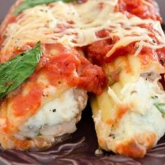 "One of things that sure puts me in a better mood is yummy food. And this one is definitely yummy. I love manicotti and I usually make them with spinach and ricotta cheese. But this time, I did something different… one because I didn't have any frozen spinach… so I thought, how should I use manicotti without any frozen spinach. And a thought came to me ""let's stuff them with some shredded chicken, Parmesane cheese and ricotta together!"