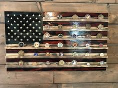 Challenge Coin Holder Old Glory: All handmade Wooden American Flag. With individually cut pieces nailed to a sturdy frame,  stained, torched for that rustic-charred style, and fixed with Challenge Coin Shelves. Then finished with 3 or more coats of high gloss poly for protection and shine that will last a lifetime. A creative way to display all your recognition for hard work!