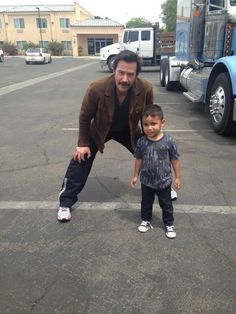 WHY DO WE LOVE KEANU? Because the inimitable Mr. Reeves will scrunch waaaayyyyy down to take a pic with his biggest, little fan! (chicfoo) keanu