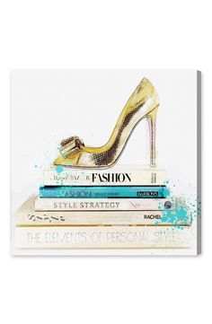 A gold, bow-topped pump stands atop a stack of fashion books, lending glam-chic flair to this canvas.