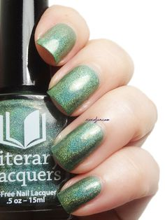Bottletown by LiteraryLacquer. Described as: a bottle green linear holo with iridescent flakies and glass flecks