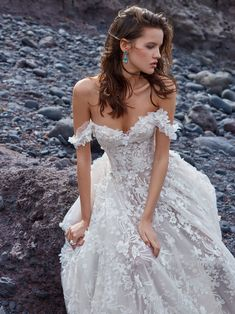 A closer look at the stunning off-the-shoulder #GALA1010 wedding dress from Collection No.5 - just look at that beautiful 3D embroidered tulle ballgown with sheer corset. #GALANo5 #GALAbyGaliaLahav #WeddingDress