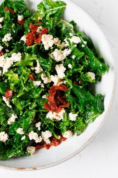 This tofu feta kale salad is fresh and light, yet packed with plant protein and good nutrition. It's made with a tangy lemon hemp dressing and sun-dried tomatoes. #vegan #plantbased Plant Protein, Kale Salad, Dried Tomatoes, Sun Dried, Vegan Life, Seaweed Salad, Tofu, Feta, Salads
