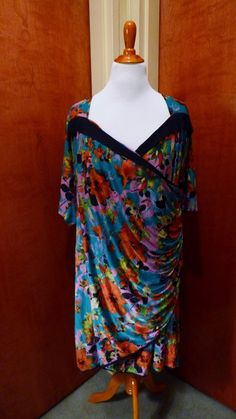 The vibrant colors in this the blue floral print of this Portia style Kiyonna plus size dress is so flattering!
