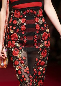 """OLE! FOR DOLCE & GABBANA SPRING 2015 """"Latin, gorgeous, sexy – they stay true to themselves,"""" said ageless, as the last shorts-wearing torero, with flowers in her hair and a symbolic gilded heart on her chest, marched off the runway into the arms of Domenico Dolce and Stefano Gabbana."""