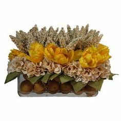 """Silk tulip arrangement in a glass vase with faux citrus accents.   Product: Faux floral arrangementConstruction Material: Silk, plastic, acrylic and glassColor: Yellow, ivory and greenFeatures: Includes faux tulips and lemonDimensions: 12"""" H x 20"""" W x 10"""" DNote: For indoor use only"""