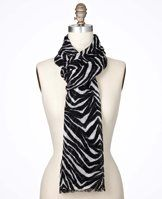 """Zebra Print Luxe Scarf - An edgy zebra print adds a dash of wild style to finish off your favorite ensemble. Light fringe at ends. 26"""" x 80""""."""
