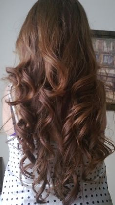 Curly red hair, curled with a flat iron.