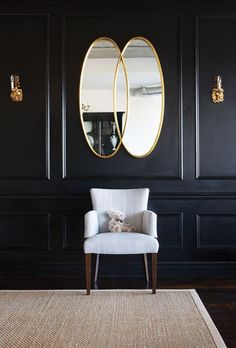 The black used to slick up wall paneling that could otherwise be fussy needs the natural colour and texture of the rug and warm metal to keep it from being too severe.  As seen in the House & Home gallery of painted trim. Photograph by Michael Graydon