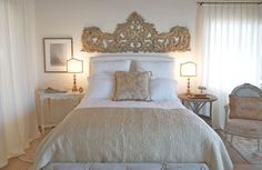 what a pretty headboard! the carved headboard and simple color palette make this small bedroom space so warm & inviting