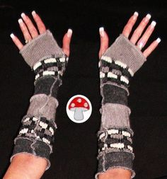 New York here I come!  Silver Lining Arm Warmers Fingerless Gloves Recycled Sweater Elf Warmies Dark Light Gray Armwarmers Extra Long Fairy Fae Wrist Gauntlets. $25.00, via Etsy.