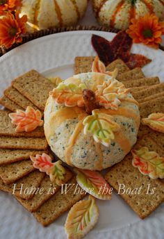 Pumpkin Cheese Ball! Pretzel rod stems and food coloring tinted egg wash on pie crust leaves for a decorative fall touch! #fall #appetizer