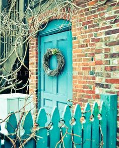 Turquoise door and picket fence