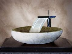 Yosemite Home Decor TRISTAN-SS Granite Stone - 18-24 x 14-20 x 5.5-7. TRISTAN-SS Yosemite Home Decors Tristan-SS Boulder Vessel Sink is made of polished sand granite stone. This sand granite vessel sink is essentially hand carved however, the help of some modern tools like small diamond saws .. . See More Stone Vessel Sinks at http://www.ourgreatshop.com/Stone-Vessel-Sinks-C710.aspx
