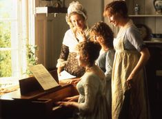 """Elinor, played by Emma Thompson on the far right, is wearing a pinafore. """"Sense and Sensibility"""" (1995)"""