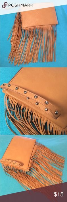 NWOT-Dolce Vita, large wristlet with chic fringe NWOT-Dolce Vita (for Target), camel colored, extra large wristlet with chic fringe. Gold studs on wrist strap. Measures approx. (without including fringe) is 11.25 in. L x 8 in. W.   Measures approx. (with fringe included) is approx. 19.5 in. L x 23 in. W. There are 6 pieces of fringe that have very minor loosening of fringe backing on them (see pic). Too cute sit in my closet!! DV by Dolce Vita Bags Clutches & Wristlets