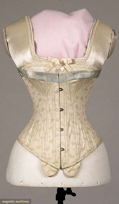 """COTTON BROCADE S-SILHOUETTE CORSET, 1900-1910 Cream cotton w/ small blue & yellow faded flowers, steel busk, blue silk satin ribbon trimmed top, corset pieced to push upper torso forward, attached tabs below busk for pin-on garters, B 28.5+"""", W 20+"""", CFL 11.25"""", (few worn spots in blue ribbon) good"""