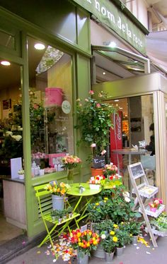 Walking In The Colorful 16th Arrondissement.  Love this  little chain of rose shops in Paris.  Known for their rose petals on the sidewalk outside their shops.