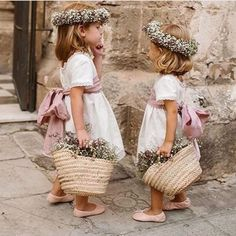 These flower girls are adorable! They look so pretty in those white dresses with pink ribbons Tell us - how many flower girls will be at your wedding? Wedding Day Weddings Planner Plan Planning Your Big Day Flower Girl Photos, Flower Girl Dresses, Boho Flower Girl, Wedding With Kids, Wedding Flower Girls, Vintage Flower Girls, Bridesmaid Dresses, Wedding Dresses, Beautiful Bride