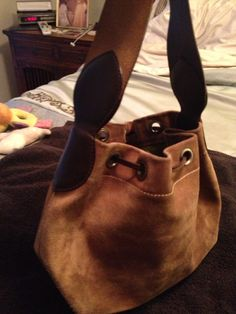 AUTHENTIC CHEAP & CHIC DRAW STRING BROWN SUEDE BAG REG 475.00 SALE  145.00 EMAIL ME  SHALL02@HOTMAIL.COM THANK YOU SHAYNE