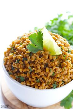 This Cilantro Lime Farro recipe is easy to make, and a great protein-rich alternative to traditional rice!
