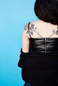 """NYC's Coolest Tattoos — 18 People Who Make Ink Look Chic #refinery29  http://www.refinery29.com/best-tattoos#slide42  """"The pair of crossed, long-stemmed roses on my back by Tamara Santibanez was just finished in January. It's not fair to choose favorites! I love all my tattoos equally, but I can say that I enjoy rediscovering the bats on my ankles, as I am a perpetual stockings-and-boots wearer, which keeps them hidden most of the time."""""""