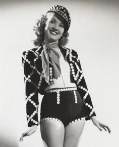 Betty Grable models a modified London Pearly Queen outfit comprising Pearled Cap, Jacket and Silk Panties. As worn in the 1941 movie 'A Yank in the RAF'