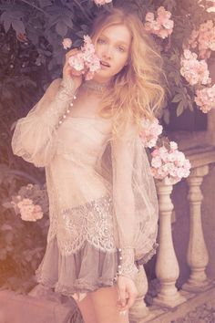flowy, sheer top and skirt, faded colors and pastel flowers.