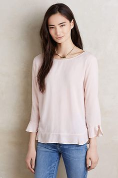 This top is so pretty.  I really like that it's simple, but the detailing at the bottom and at the sleeves make it unique.  I also really like this neckline.
