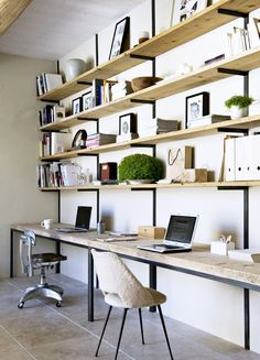 Raw wood shelves and desktops supported by iron brackets with shearling desk chair.                                                                                                                                                                                 More