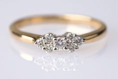 antique-engagement-ring-2... very pretty and diamonds are not too big and not to small