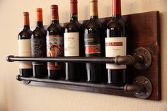 Stylish Rustic Wooden Hanging Wine Rack Design Ideas - Page 21 of 43 - Abantiades Decor Hanging Wine Rack, Wine Rack Wall, Wine Wall, Industrial Wine Racks, Rustic Industrial, Pipe Furniture, Rustic Furniture, Wine Rack Design, Wine Display