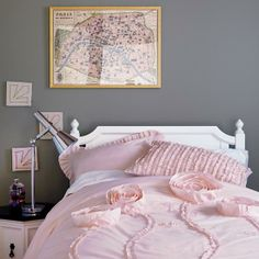 A new room for Natalie and her sister? Wall color, white furniture, and pink decor.