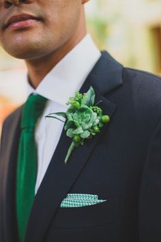 Succulent and hypernicum berry boutonniere