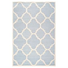Light blue and ivory wool rug with a quatrefoil trellis motif. Hand-tufted in India.   Product: RugConstruction Mater...