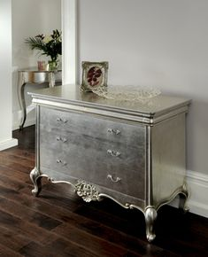 metallic painted dresser--- ohhhhhh I wanna do this to my dresser that i'm gonna turn into a tv stand. LOVE the metallic paint over normal colored paint.