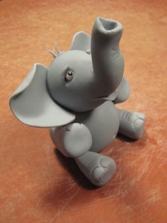 Gumpaste Elephant - My first ever gumpaste figure! I'm pretty proud of this little guy. It's based on tutorials from Aine2 as well as looking at lots of other people's work - so thanks to everybody!