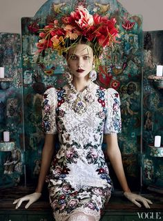 """""""The wildlife and [fauna] in Brazil is amazing. I was constantly picking flowers off the bushes and trees and sticking them into my hair before dinner. For this shot, [hairstylist] Julien d'Ys collected different flowers that were growing around the hotel and made them into a gorgeous headpiece in a moment of inspiration."""""""