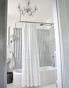 Sheets of corrugated metal (available at most Home Depot stores) make a stylish tub surround. After removing the plastic tub surround, cut the galvanized sheets to fit and finish the panels with Rust-Oleum Crystal Clear Enamel before screwing them in plac Bad Inspiration, Bathroom Inspiration, Baños Shabby Chic, Rustic Chic, Rustic Elegance, Farmhouse Chic, Rustic Barn, Rustic Modern, Barn Wood
