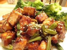 Vegan General Tso's TofuFor the Sauce  1 tbsp. sesame oil ¼ cup gluten-free, low-sodium tamari 1 tbsp. arrowroot 1 tbsp. fresh ginger, grated or 1 tsp. ground 3 tbsp. vegan honey or agave nectar 2 tsp. hot sauce (optional) 1 tbsp. canola oil or peanut oil 4-5 scallions, thinly sliced 4 cloves garlic, minced Sesame seeds, for garnish