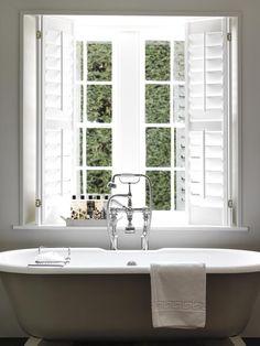 White shutters recess mounted, freestanding bath
