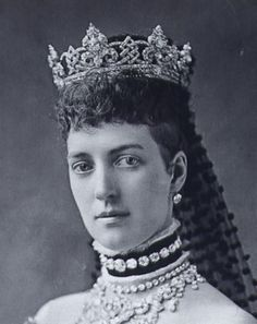 "Queen Alexandra wearing the ""Rundell"" Diamond Tiara, a wedding present from the groom, Edward Prince of Wales.  Part of a monumental parure of diamonds, diamond tiara/coronet with matching necklace, brooch and earrings with pearls and diamonds.  The Princess wore it on her wedding day."