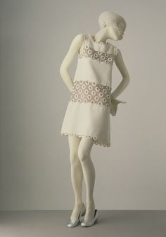 Mini-dress  Place of origin: Paris, France (made)  Date: 1967 (made)  Artist/Maker: Courrèges, André, born 1923 (designer)  Materials and Techniques: Cotton and machine-embroidered organza, lined with silk  Credit Line: Given by Princess Stanislaus Radziwill  Museum number: T.100-1974  Gallery location: In Storage