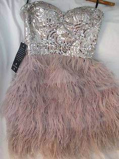 I LOVE LOVE LOVE feathered bottom dresses with sparkly tops, plus the pretty pink color is one of my favs. I'm so in love with this. Need it!!!