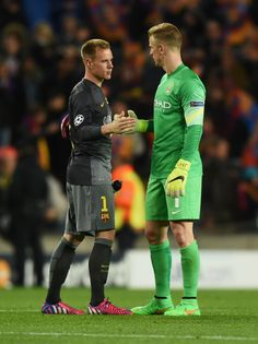 Marc-Andre ter Stegen of Barcelona shakes hands with Joe Hart of Manchester City after the UEFA Champions League Round of 16 second leg match between Barcelona and Manchester City at Camp Nou on March 18, 2015 in Barcelona, Catalonia.